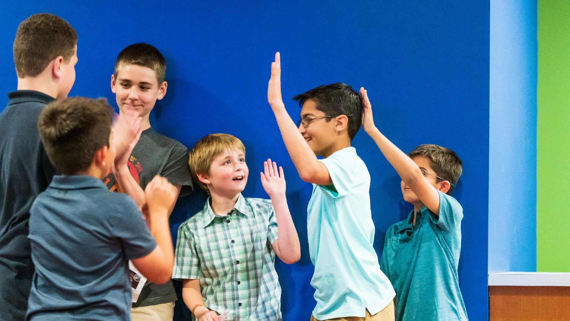 A group of kids high-fiving at Brookwood Church on Sunday